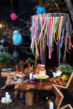 Scandi wedding dessert table with semi naked cake, redcurrant friands and cinnamon buns by Laura at Yolk. We love our DIY ribbon chandelier!   Kook Events: Yorkshire Wedding Planner and Wedding Stylist. Woodland Scandi Boho Colourful Themed Styled Shoot in York