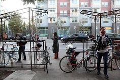 The Four Barrel Coffee parklet - one of seven in the Valencia Street area - has two bars, with bicycle parking in between.