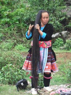 Hmong lady letting her hair down after leaving the Sunday market at Sin Ho in NW Vietnam. Sin Ho is 8 hours drive west of Sapa