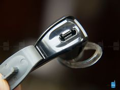 Hidden behind a plastic flap on the right ear bud, there's a microUSB port - Plantronics BackBeat Go 2 Review