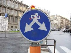 Smart And Savvy Street Signs By Clet Abraham Street Street Art - Brilliant street artist modifies road signs giving them a whole new meaning