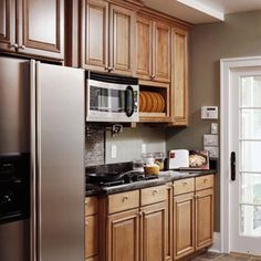 Fridge and stove on same wall - counter between. Like kitchen door too.