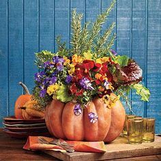 Blooming Pumpkin | Learn how to make this beautiful pumpkin arrangement with violas, pansies, lettuce, and herbs. | SouthernLiving.com
