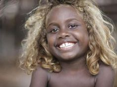 Australian Aborigine. Good Lord, I could just smother this one in cuddles....