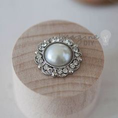 Pretty pearl embellishment with crystal details. Decorate wedding invitations with crystal and pearl embellishments. DIY wedding stationery supplies