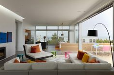 Bright cushions. Beach Walk House / SPG Architects | ArchDaily