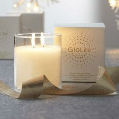 """Iced Snowberries GloLite by #PartyLite Jar cande - The same instant, all-over glow of our popular GloLite pillars, plus a richer, stronger scent. Enjoy the magical shimmer of GloLite technology paired with our Iced Snowberries™ fragrance, a blend of sweet berries and fruits dusted with vanilla and musk. 4""""h, 3¾""""dia. Burn time: 50-60 hours."""
