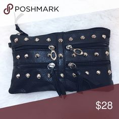 Black Leather Studded Clutch Black hand clutch from Nordstrom. This is a stylish hand clutch with front studded and zipper pockets. Excellent condition!  I do not do trades but I do accept reasonable offers. Nordstrom Bags Clutches & Wristlets