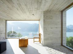 Overlooking Lake Maggiore in Switzerland is the 'Concrete House'. Characterised by large expanses of concrete with timber features and the best of V-ZUG's Swiss technology, this house is a trademark of designers Wespi De Meuron. Architecture Design, Concrete Architecture, Minimalist Architecture, Architecture Wallpaper, Concrete Interiors, Concrete Houses, Concrete Walls, Concrete Ceiling, Concrete Finishes