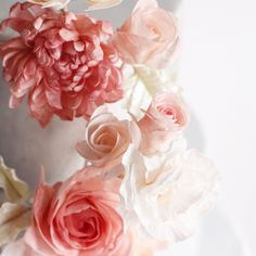 Cascading sugar flowers. #winifredkristecake #sugarflowers