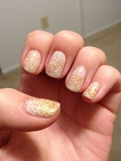 Cnd studio white with gold glitter on top