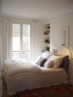 Catbed that big enough to cover most of the bed to keep it clean from fur, looks nice too  A Gallery of Inspiring Small Bedrooms