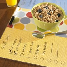 Checklist placemat for kids made with poster board and clear contact paper.