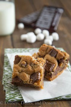 S'mores Cookies Bars Ingredients: 1 1/2 cups Graham Crackers (1 sleeve), 1/2 and 1/3 cup butter, 1/2 cup shortening, 1 cup sugar, 3/4 cup brown sugar, 2 eggs, 1 tsp vanilla, 2 1/4 cups flour, 1 tsp salt, 1 tsp baking soda, 1 1/4 cup mini marshmallows, 1 bag chocolate chips, 3 Hershey Bars