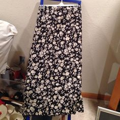 Black/yellow/little bit of green size Black with yellow flowers with touch of green in them. Dresses