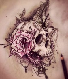 Amazing design. Skull with rose, feather and some necklaces.