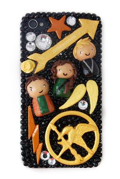 DIY Inspirtion: Hunger Games Kawaii iPhone Case bydimeycakeson Craftster.org here.She used a mold for the Mockingjay symbol - the mold and pin on the phone case are almost definitely polymer clay. She writes:    All cabochons are made with white Sculpey polymer clay and painted with acrylic paints, then glazed with Triple Thick Gloss Glaze (:    For more of her Kawaii cases go to dimeycakes here.*First seen at Geek Crafts here.