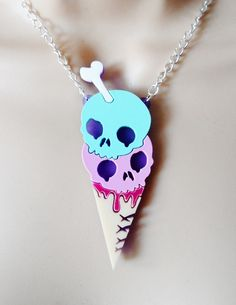 Part of our pastel collection this piece features a creepy cute double scoop of skull ice cream with oozing raspberry sauce and bone flake. It measures 7cm and is suspended from an allergy free 18 inch silver plated curb chain. Your purchase will be gift wrapped ready for giving or as a treat for yourself.