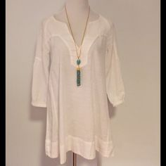 Zara Basic White Cotton Dress They say dress... I say beach tunic... It's sheer! And gauzy and you'd pay $150 for anything like it at Calypso. 100% cotton and 29 1/2 inches from the shoulder to hem. Zara Dresses