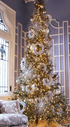 pretty....with silver starburst and small white wreaths scattered evenly throughout the tree....