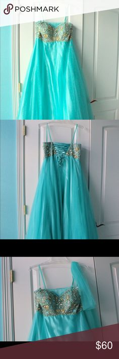 Long aqua prom dress Bling prom dress only worn once! Lace up back, meaning it fits a medium or xl easily. Dresses Prom