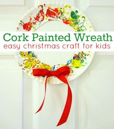 Christmas craft for kids-cork painted wreaths from paper plates. To make it more tactile, glitter could be sprinkled into the paint and onto the wet paint on the wreath.