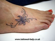 Lily and swirls foot tattoo
