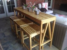 Outdoor Console Bar Table and Stools | Inspired by Ballard Designs Sutton Collection  Just completed -- and excited how well this fit on our covered porch. Best part: Lumber cost for entire project was around $100, plus another $40 for screws, stain, spar urethane, and some replacement wood glue. Stained with Minwax Puritan Pine to mimic that fresh teak color then clear coated with outdoor spar urethane.