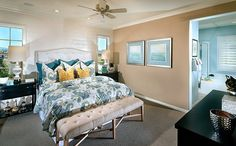 Master bedroom is located upstairs and features a walk-in closet and private bath with separate shower and soaking tub. - Residence 1X at Hillsdale at College Park in Chino, CA