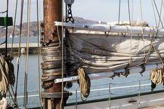 hawser: The hawser on the sailboat mast and the square sail Sailing Pictures, Sailboat, Royalty Free Images, Boats, Ships, Stock Photos, Sailing Boat, Sailboats, Boat