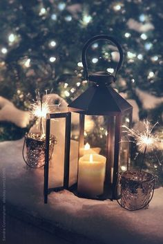 Lantern and sparklers lit for holiday celebrations by Sandra Cunningham . - Lantern and sparklers lit for holiday celebrations by Sandra Cunningham- Lantern and sparklers lit - Christmas Lights Wallpaper, Christmas Phone Wallpaper, Holiday Wallpaper, Winter Wallpaper, Christmas Lanterns, Christmas Mood, Noel Christmas, Christmas Decorations, Christmas Aesthetic