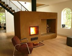 The masonry heater burns with an environment-friendly wood-fire.