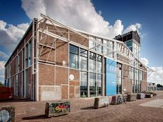 A transforms the historic remnant of smederij NDSM in amsterdam GROUP A transforms the historic remnant of smederij NDSM in amsterdam - designboom Public Restaurant, Amsterdam Skyline, Industrial Architecture, Shed Roof, Brickwork, Steel Structure, Urban Planning, Stairways, Exterior