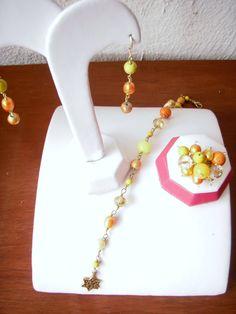 Aretes, pulsera y anillo, combinado amarillo, naranja y dorado..