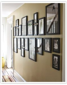 I've been looking for a neat way to arrange my picture frames in the hallway. This might work..if I get new frames.