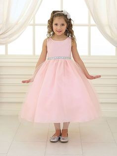 What a gorgeous Flower Girl Dress for your little girl. Tea length tulle dress with delicate rhinestone belt waist and classic sleeveless satin bodice. Fully lined and comfy to wear, this lovely littl