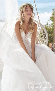 Boho a-line wedding dress with lace bodice and flowy skirt for your elopement or microwedding | Affordable Wedding Dresses - Mavis by Rebecca Ingram- Belle The Magazine #weddingdress #weddingdresses #bridalgown #bridal #bridalgowns #weddinggown #bridetobe #weddings #bride #dreamdress #bridalcollection #bridaldress #dress See more gorgeous bridal gowns by clicking on the photo
