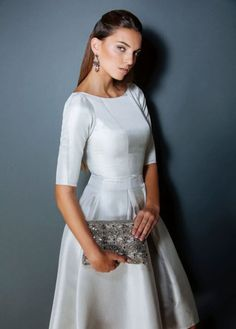 Designed and made by brand Caroline Mode Pure. - Knee length skirt - Made with beautiful wild silk fabric - Princess line bodice - Boat neck - 3 pleats on the front starting at the waist; and 2 pleats at the back. - 3/4 Sleeve length This stun