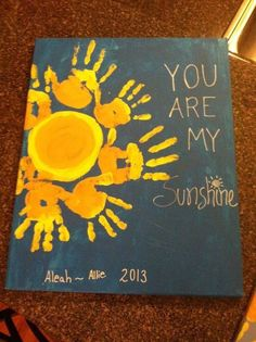 My Favourite Song to sing to My Children and Grandchildren - Sunshine handprint art. A cute art idea for kids to make in the summer!