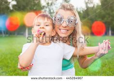 Funny mother with child outdoor has a party time. Family lifestyle. Happy boy and mom