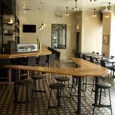 The boomerang table is meant to evoke an old-school surf board.  GT Fish & Oyster (Chicago)