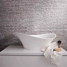 <3 textured tiles <3 And this countertop basin is so beautiful. A great way to add hotel-chic to your bathroom