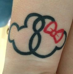 Love this Mickey and Minnie tattoo. I would do a really small, subtle version of this.