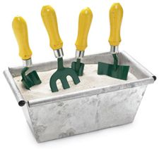 If you have a bit of room, keep your garden tools clean and rust free with this simple idea!      Take a small bread pan and fill it with sand.  Then add 2 tablespoons of motor oil to the mix!  Stir until it's all mixed.    It will help keep your tools lubricated and soil free while keeping rust at bay!