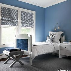 blue and gray boy s bedroom features a wall painted blue framing a rh pinterest com