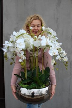 How To Keep Orchids Alive And Looking Gorgeous Orchid Flower Arrangements, Orchid Planters, Orchid Centerpieces, Artificial Flower Arrangements, Flower Planters, Flower Pots, Indoor Flowers, Artificial Orchids, Phalaenopsis Orchid
