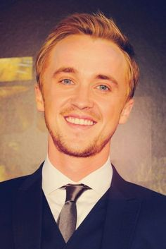 TOM FELTON COULD NEVER BE HOTTER.