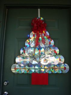 """""""how to"""" guide for making a Christmas tree door decoration using old compact discs. After all, what says """"festive holiday decoration"""" more than that rainbow luminescence of the business side of a compact disc?"""