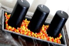Halloween decorations - super simple black pillar candles on a tray with candy corns. Colorful and festive!