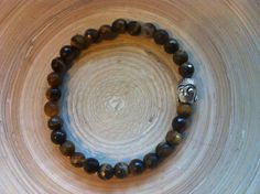 Pulseira Olho de Tigre c/ Buda via roots shop. Click on the image to see more!